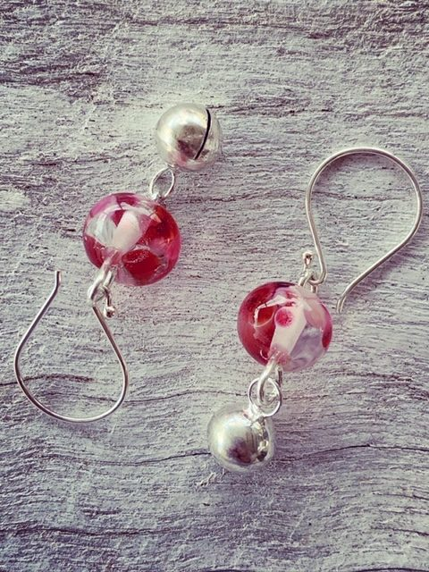 pink recycled glass earrings made from a wine bottle