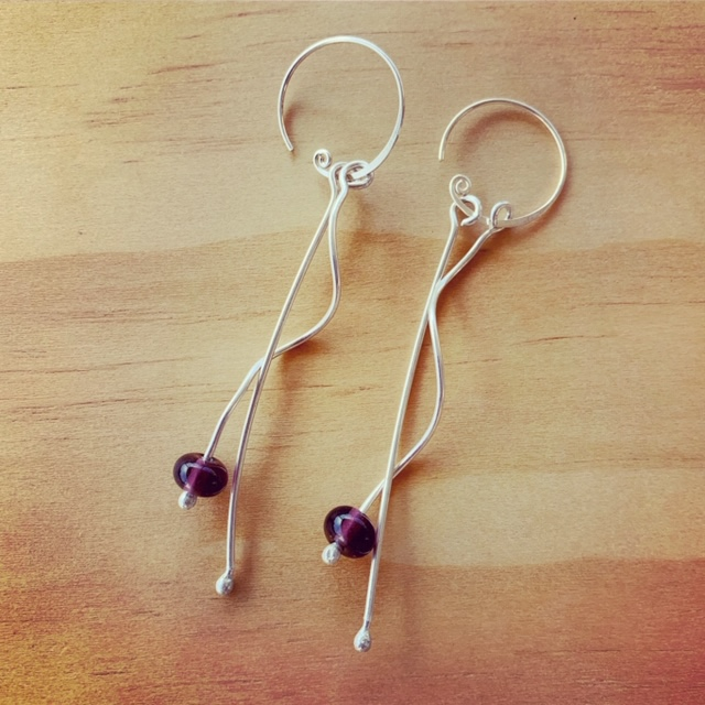 Long, dangly, curly silver earrings with Hendrick Gin - Limited Release bead