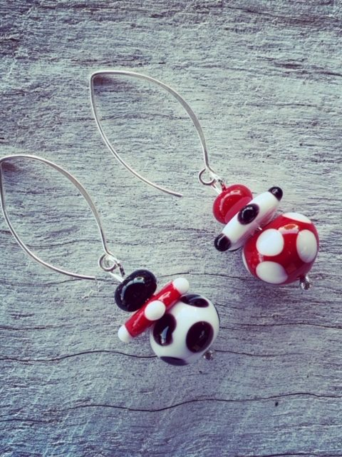 Red, black, white mismatched earrings