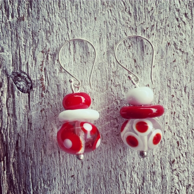 Red and white spotty mismatched earrings
