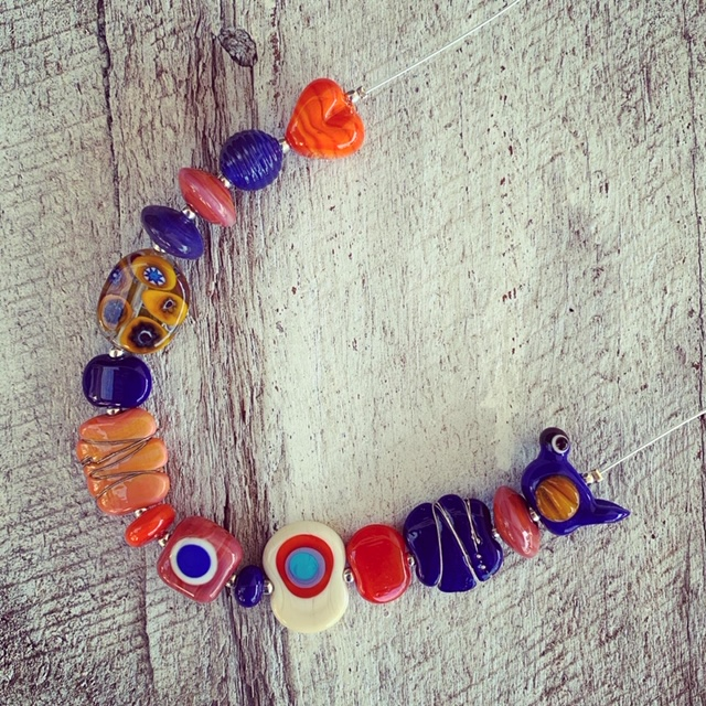 Blue/orange flower and bird necklace