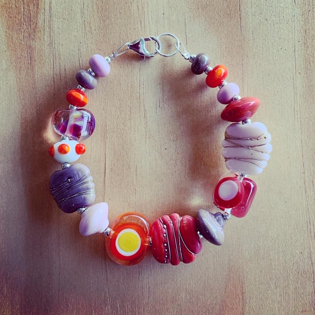 Pink and purple with a pop of orange bracelet