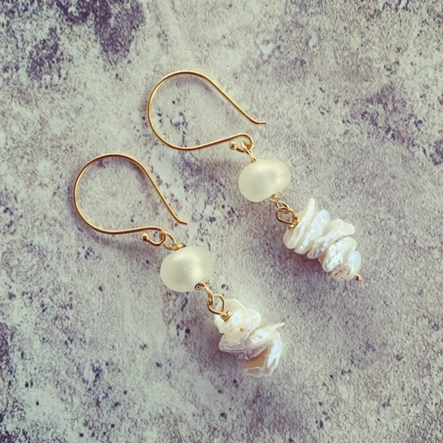 Gold wine bottle and pearl earrings