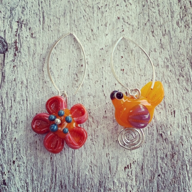 Orange mismatched bird and flower earrings