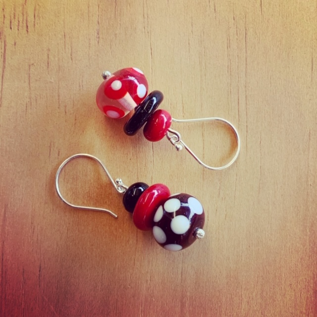 Red, black and white mismatched earrings