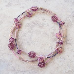 long purple glass bead necklace