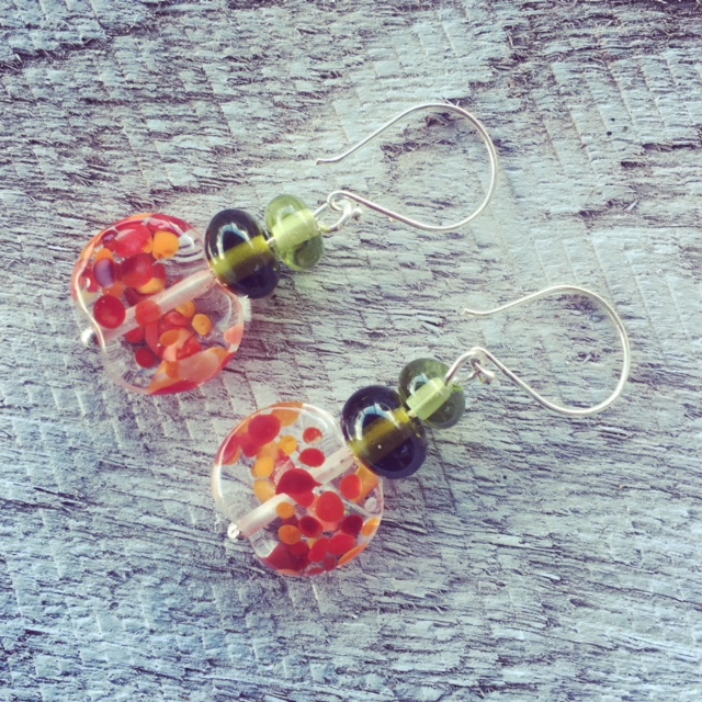 Handmade recycled glass bead earrings | red beads made from a tonic water bottle, green beads from wine bottles.