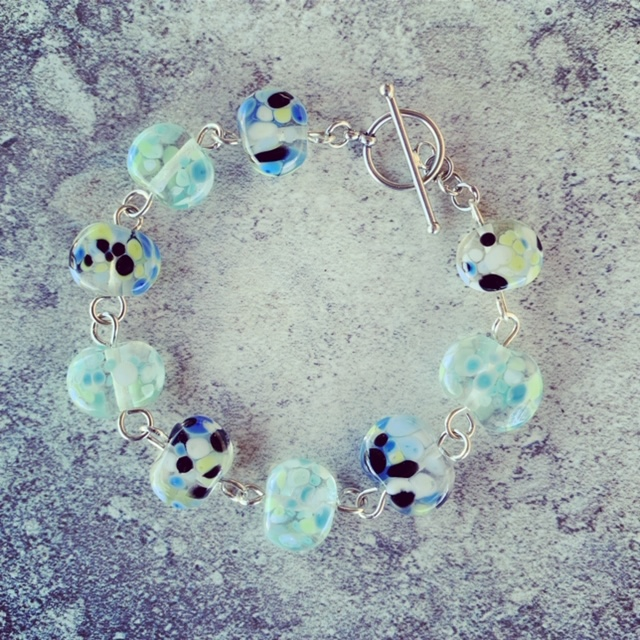 Recycled glass bracelet | beads made from a wine bottle and decorated with smashed up glass