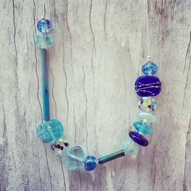Recycled glass necklace | recycled glass beads made from assorted glass like wine, gin and vodka bottles.