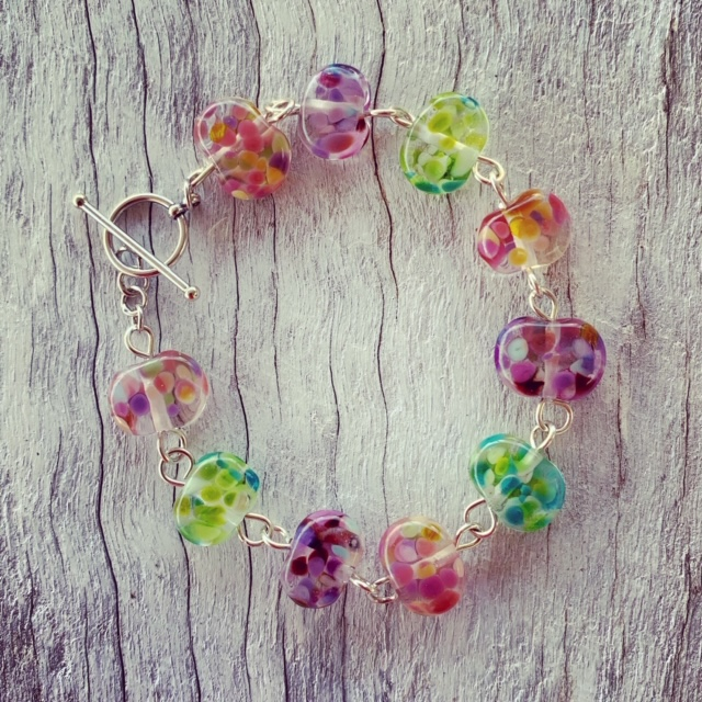 Recycled glass beads | bracelet made from a wine bottle and decorated with pinks and purples and greens