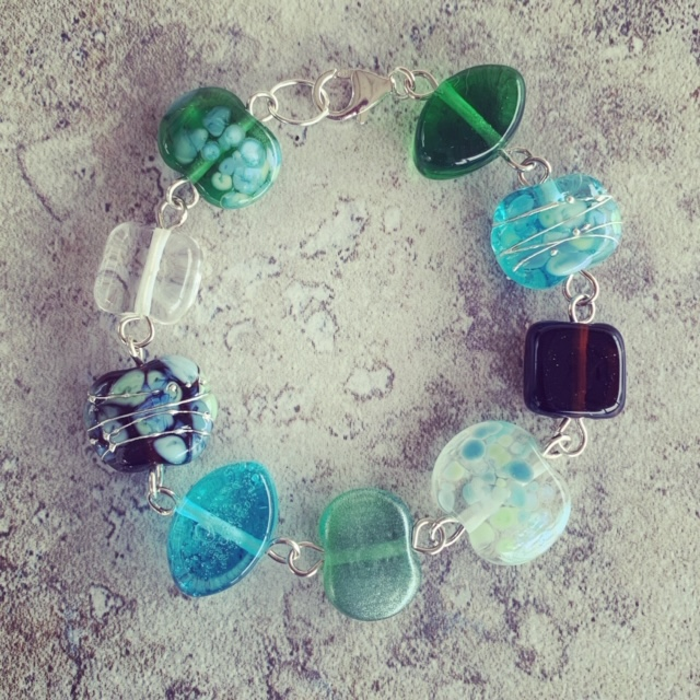 A beautiful glass bracelet, featuring beads made from gin and tonic bottles