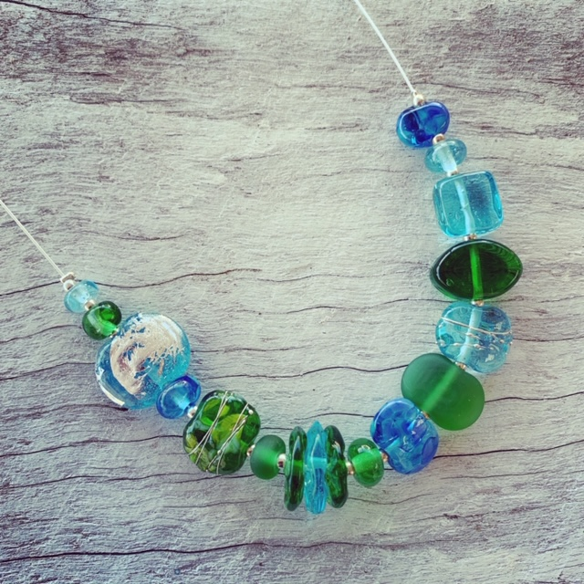 Gin and tonic necklace featuring beads made from Bombay Sapphire and Tanqueray Gin bottles