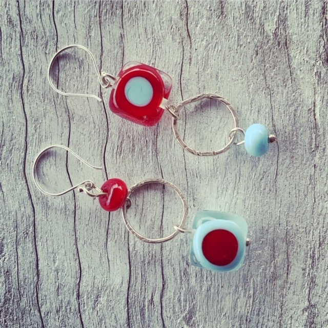 New red and blue mismatched earrings