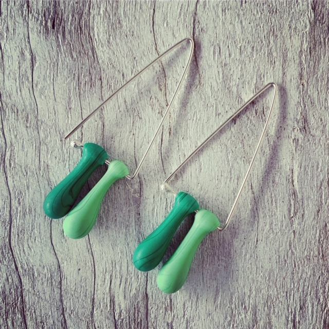 Long green triangle earrings