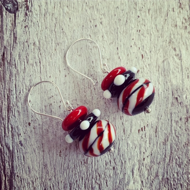 red, black and white earrings