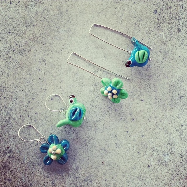 mismatched bird and flower earrings