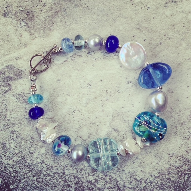 blue recycled glass and pearl bracelet